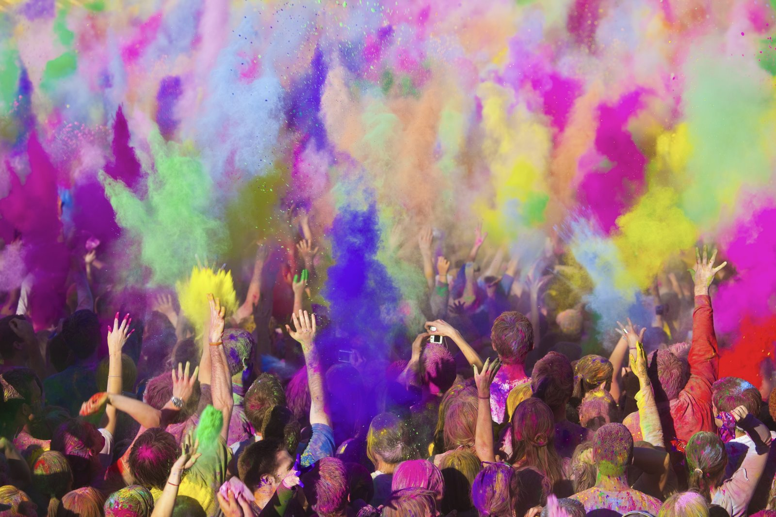 college students celebrating Holi Day with color dyes on campus